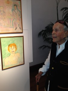 David Wolkowsky admiring a portrait of Michael Yorke, by Tennessee Williams